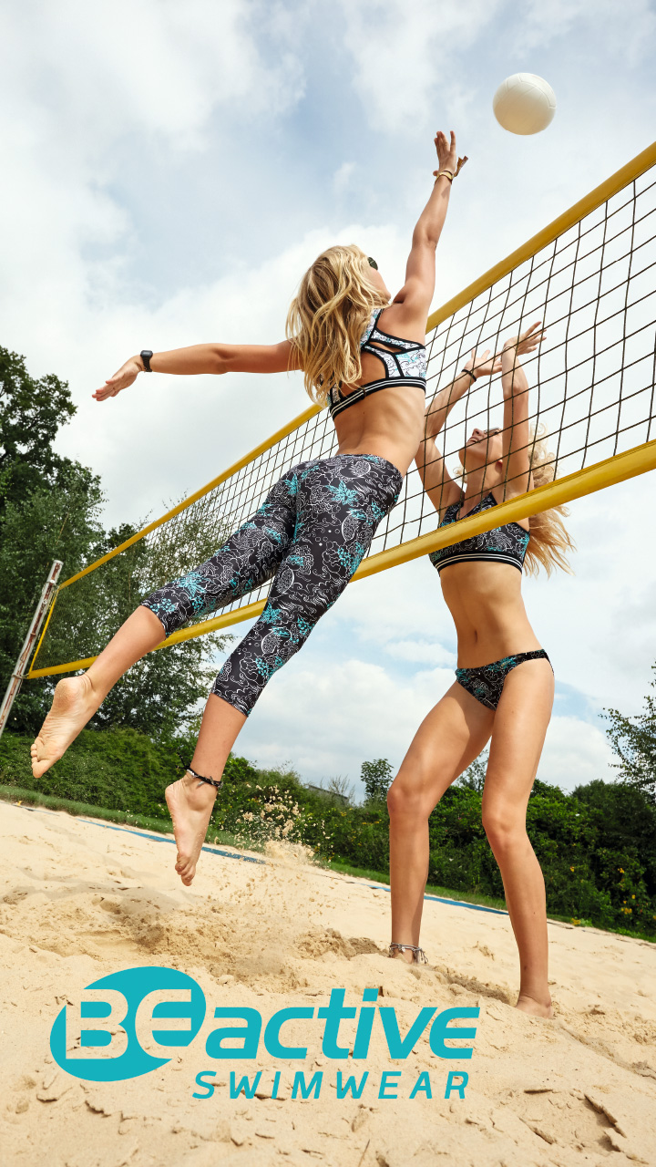 Two women playing beach volleyball