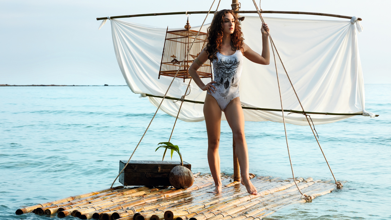 A woman is standing on a raft.